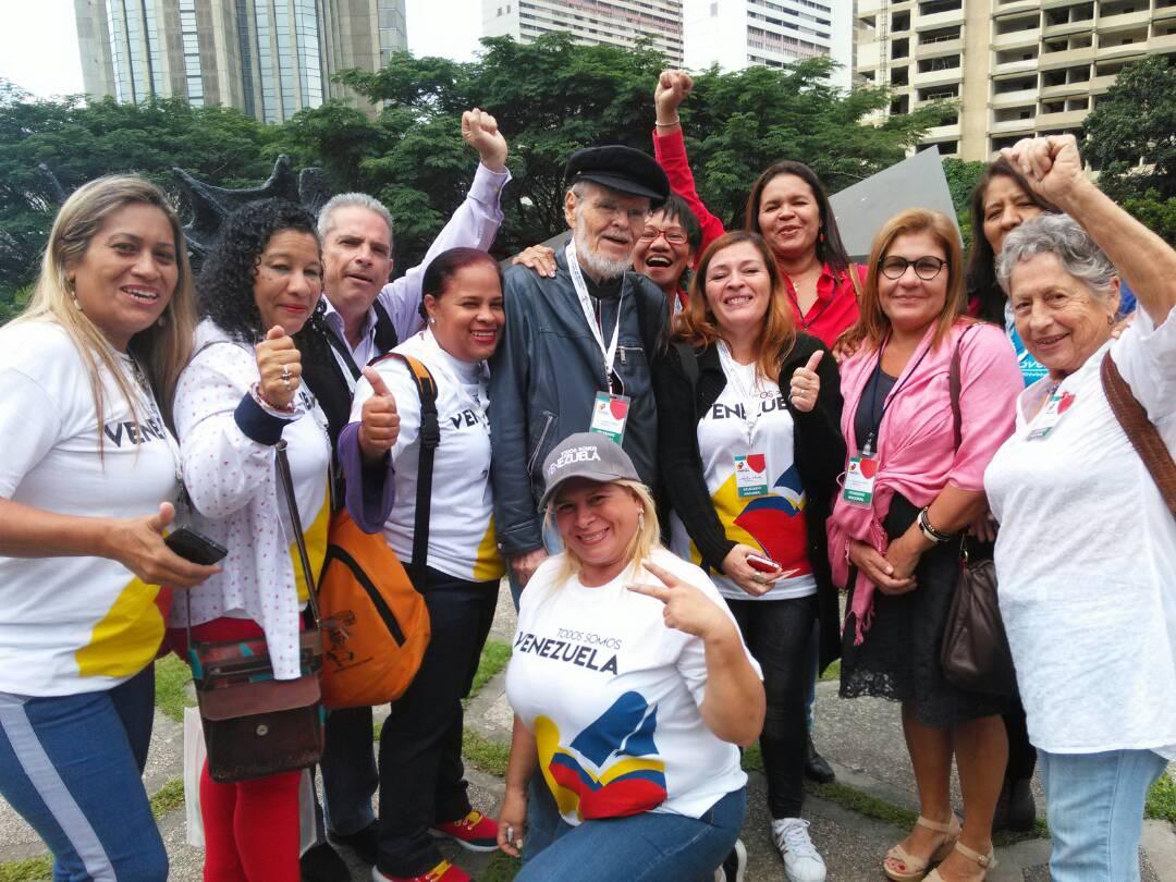 nternational delegates gather with Venezuelan political theorist and historian Luis Britto Garcia