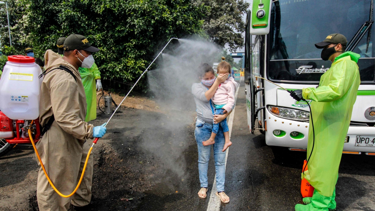 A number of COVID-19 cases have reportedly been discovered in returning migrants on Venezuela's border. (AFP)