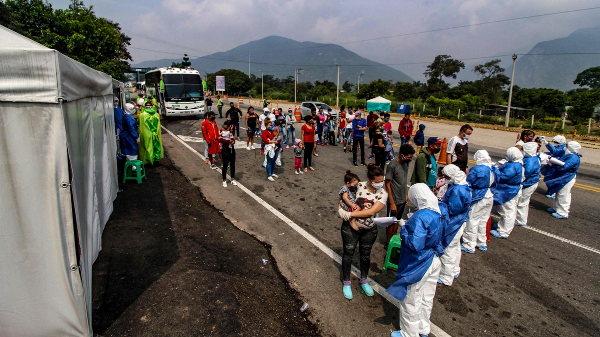 Venezuelan emigrants are disinfected upon returning to the country after fleeing rising COVID-19 cases in neighbouring countries. (AFP)
