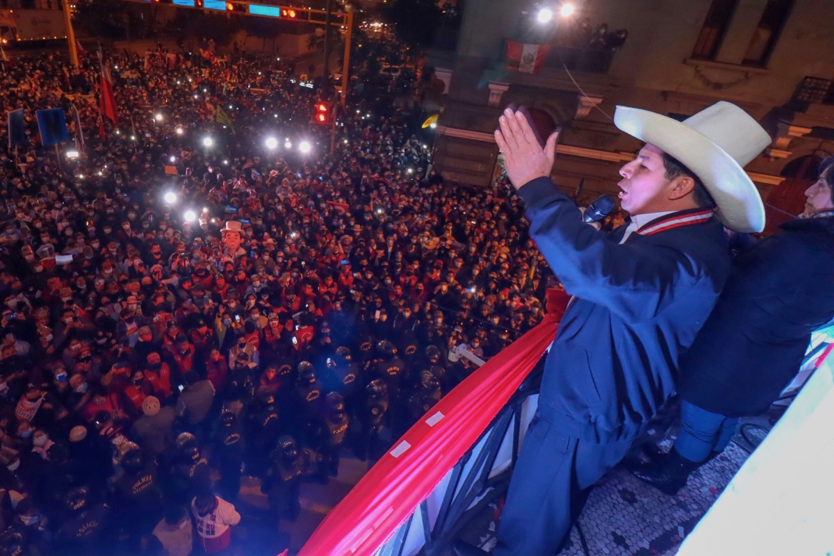 Pedro Castillo Terrones greets supporters from a balcony