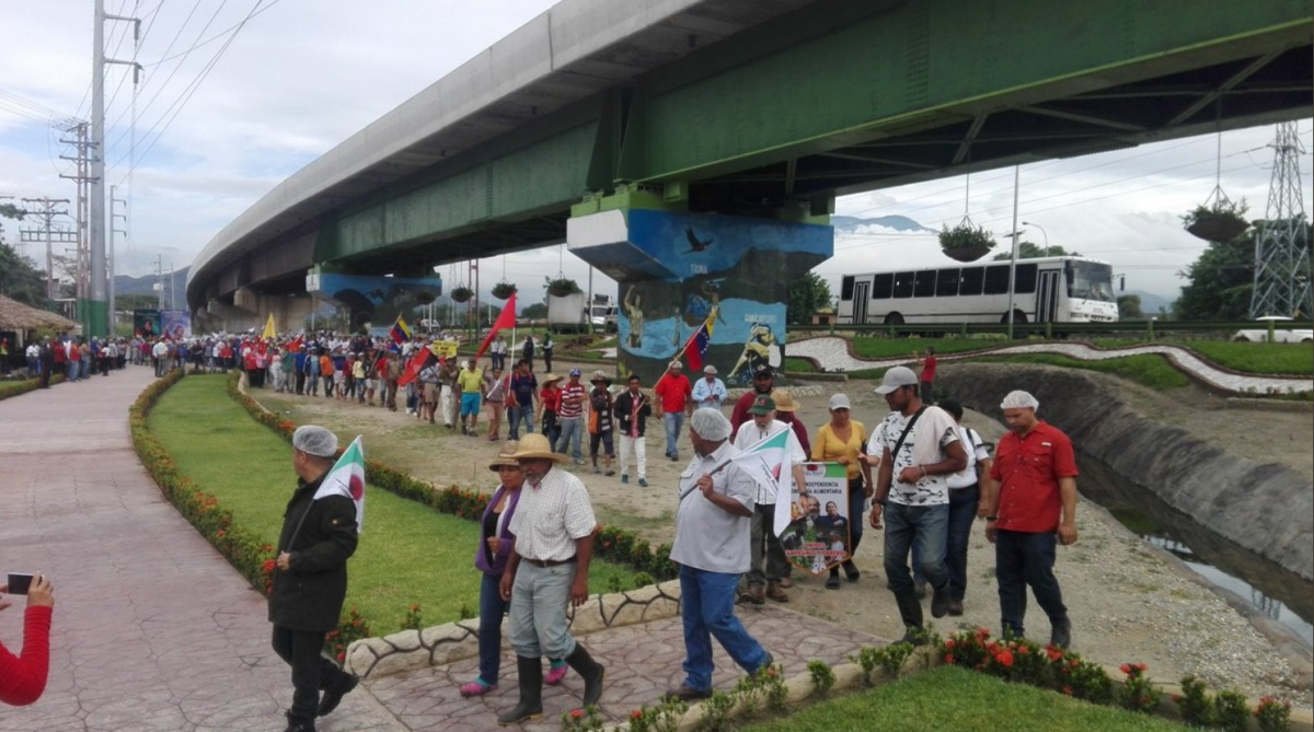 The Admirable Campesino March meets with workers from the Kimberly Clark factory, now referred to as Cacique Maracay after it's nationalization in 2016, in a show of unity between workers and campesinos.