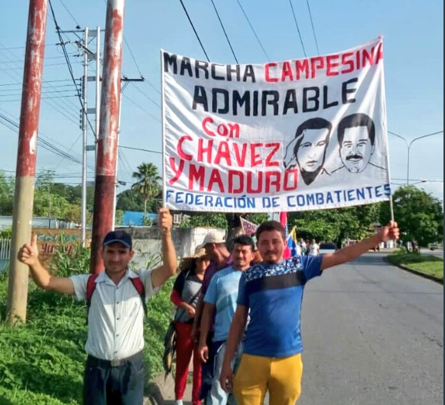 Participants expressed their affiliation with Chavismo and President Maduro in banners and signs.