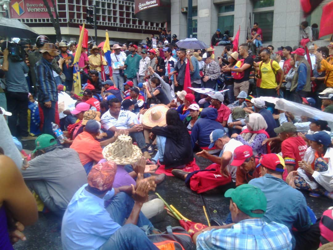 Peaceful sit down protest in front of police barricades in Caracas