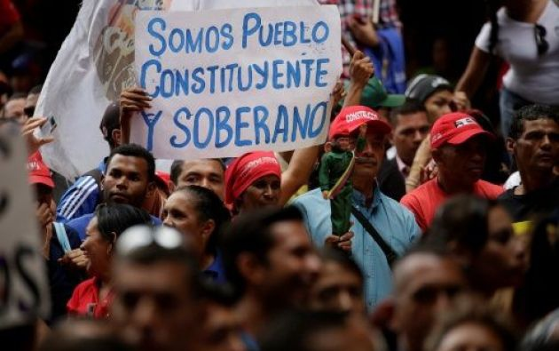 """We are the constituent pueblo"" reads the banner. (teleSUR)"