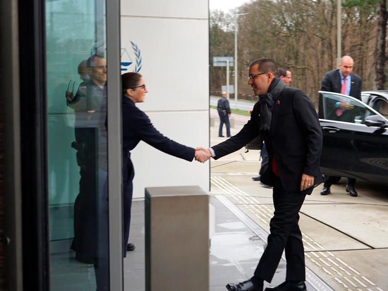 Venezuela's Foreign Minister Jorge Arreaza is greeted at the International Criminal Court in The Hague, Holland, on Thursday where he introduced a lawsuit requesting that the organisation open an investigation against the US government. (MPPRE)