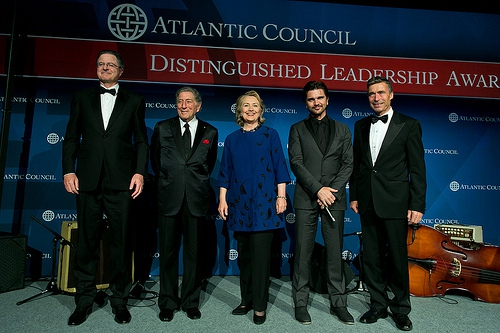 "In 2013, the Atlantic Council presented an ""international distinguished leadership award"" to then-Secretary of State, Hillary Clinton. (Atlantic Council)"