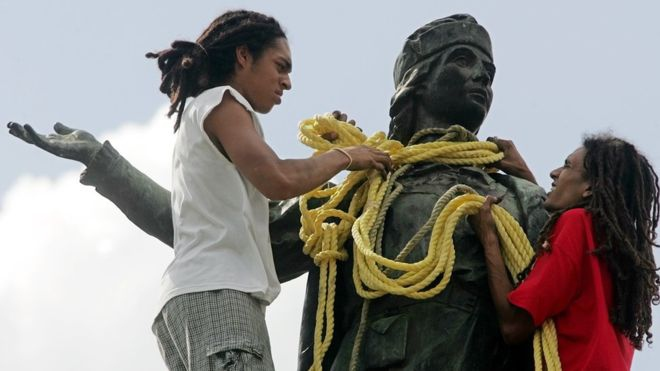 Venezuelan revolutionaries tear down a statue of Christopher Columbus in central Caracas in 2004. (Reuters)