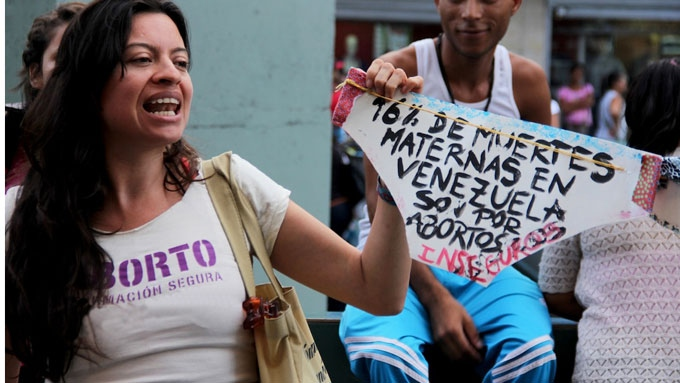 "Campaigning material reads ""16% of maternal deaths in Venezuela are due to unsafe abortions."" (VTActual)"