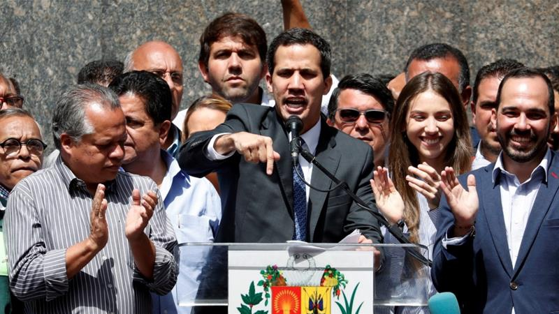 Venezuela's opposition leader Juan Guaido speaks during a news conference in Caracas on January 25, 2019 (Reuters/Carlos Garcia Rawlins)