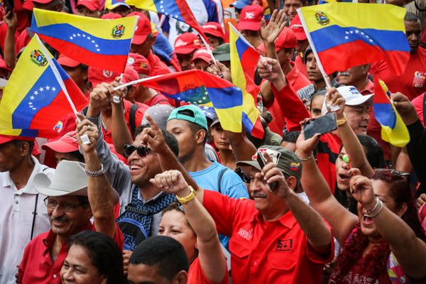 Thousands attend an anti-imperialist march in Caracas. (Carlos Barria/Reuters)