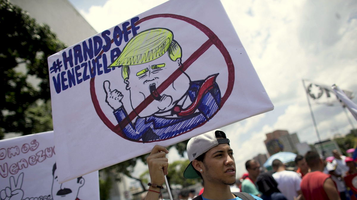 A government supporter protests US sanctions against Venezuela during an anti-imperialist demonstration in Caracas