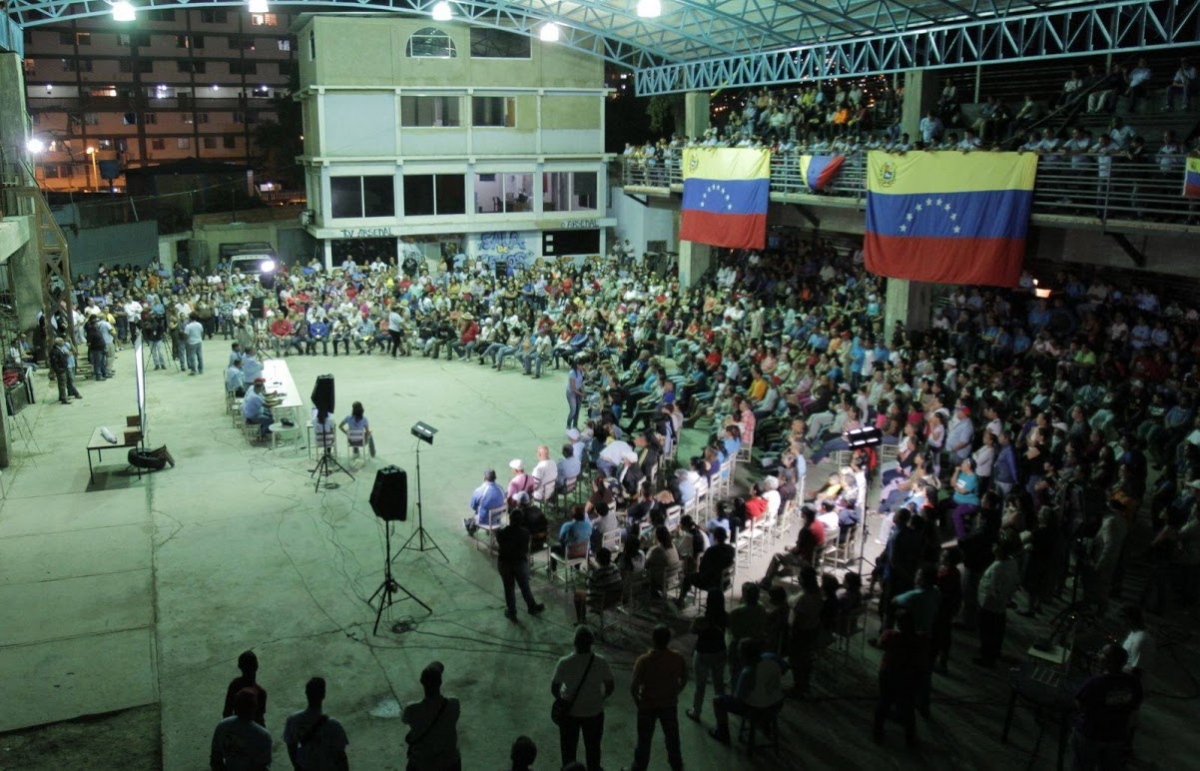 "Direct, participatory democracy is at the core of Chavez's communal project. Here a ""Patriotic Assembly"" in El Panal Commune in 23 de Enero, Caracas"
