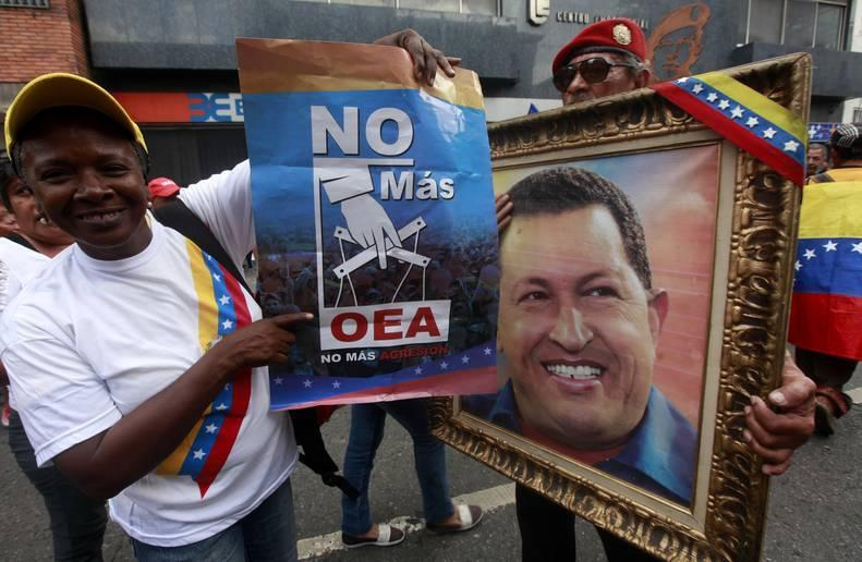 """No more OAS, no more aggression,"" read the poster from one of the marchers at Saturday's celebration of Venezuela's withdrawal from the Organisation of American States. (Rosalia Barreto / AVN)"