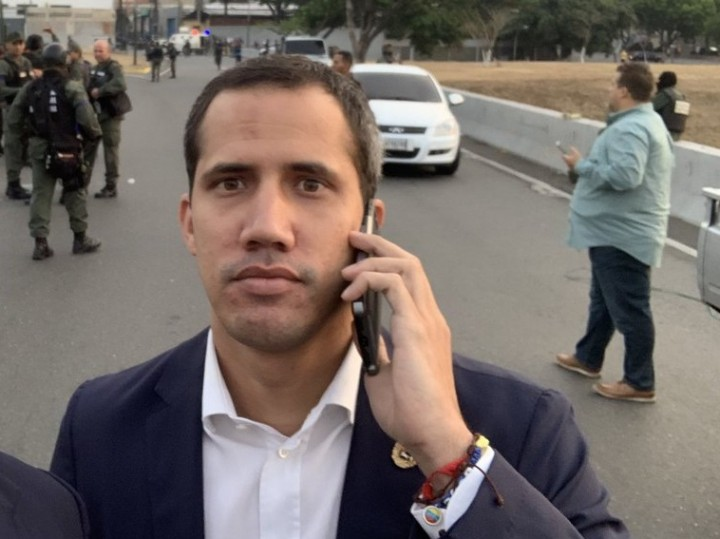 National Assembly President Juan Guaido speaks on his phone on April 30 (Archive)