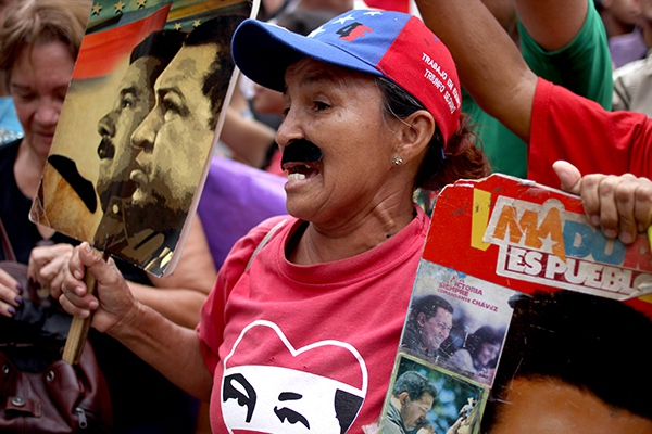 Female worker ports a mustache in support of Maduro in May Day march 2018 (Credit:  Eduardo Viloria Daboín/CBRZ.org)
