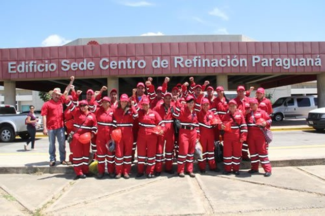 The 'Jose Leonardo Chirino Workers' Productive Battalion' celebrates after culminating the restoration and repair work in the massive Paraguana Refining Complex (PDVSA)