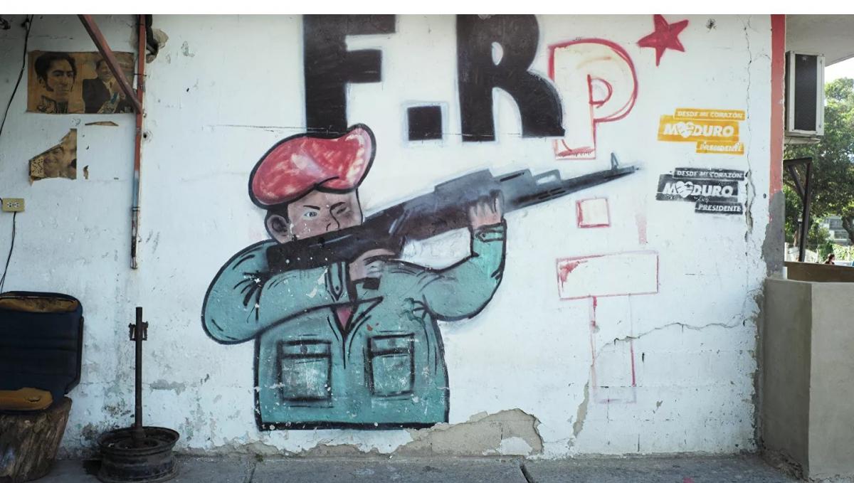 A Caracas mural depicts former president Hugo Chavez with a gun. (Ronald Pizzoferrato)