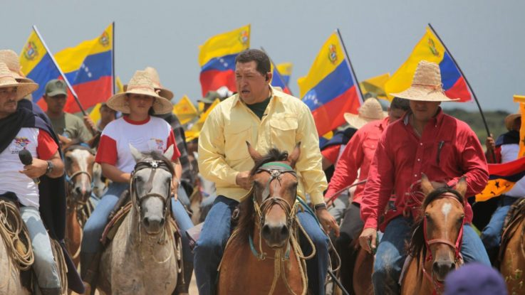 "Chavez began the democratization of the land. Here he visits a ""Fundo Zamorano"" (recovered hancienda) in Barinas state in 2006. (CRBZ)"