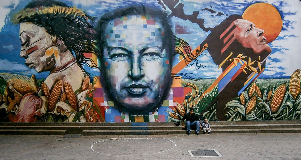Graffiti depicting late President Hugo Chavez in Caracas. (Wikipedia)