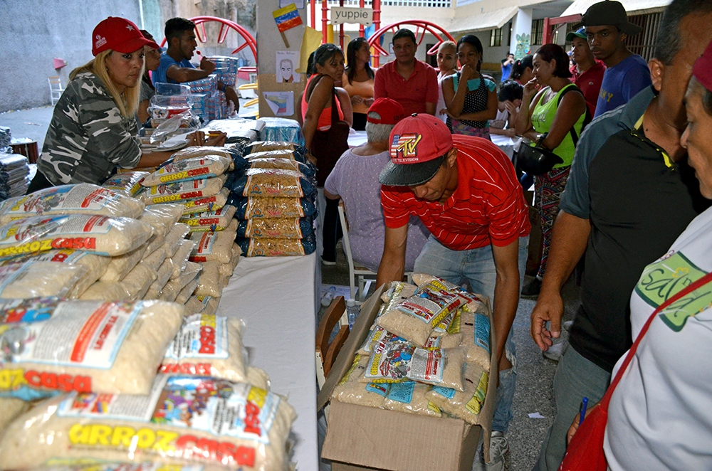 The subsidized CLAP food program reaches 6 million Venezuelan households. (Gloria La Riva, Liberation photo)