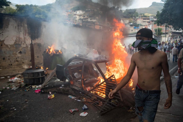 Local residents erected burning street barricades following the soldiers' arrest
