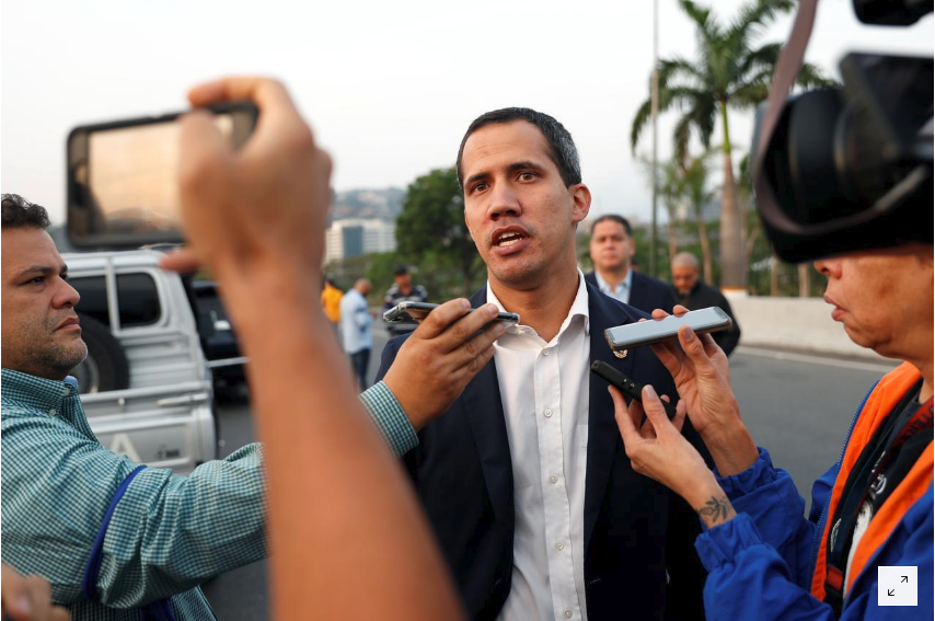 "Self-proclaimed ""Interim President"" Juan Guaido speaking to press during an attempted coup on April 30. (Reuters)"