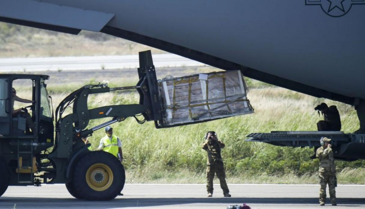 US military personnel unload packages only eight kilometres from the Venezuelan border