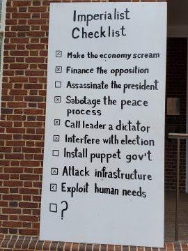 Billboard hanging outside Venezuela's embassy in DC. (Popular Resistance)