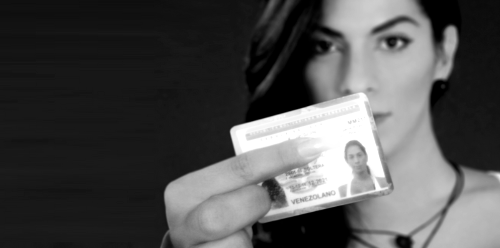A trans woman shows her ID with her dead or former name. Although trans people in Venezuela can legally change the name and gender that appears on their national ID, the process can take years. (Archive)