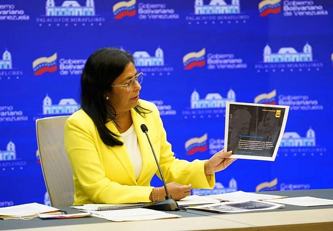 Venezuelan Vice President Delcy Rodríguez shares content from a report submitted to the ICC during a press conference at the Miraflores Presidential Palace in Caracas. (Alba Ciudad)