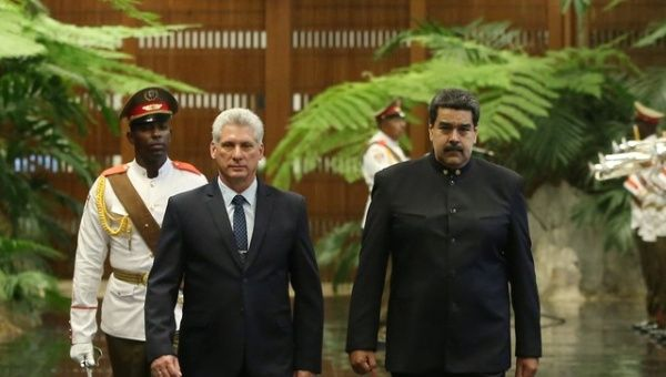 Cuban President Miguel Diaz-Canel (L) and Venezuela's President Nicolas Maduro review an honour guard during a ceremony at the Revolution Palace in Havana, Cuba (Reuters)