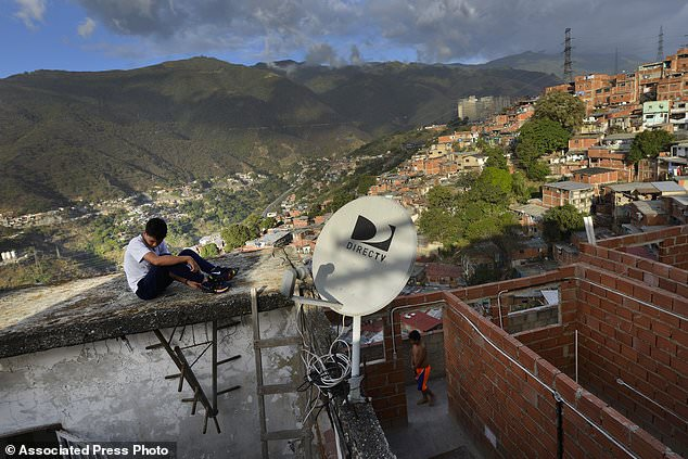 DirecTV serves approximately two million homes, including residents of working class barrios. (AP)