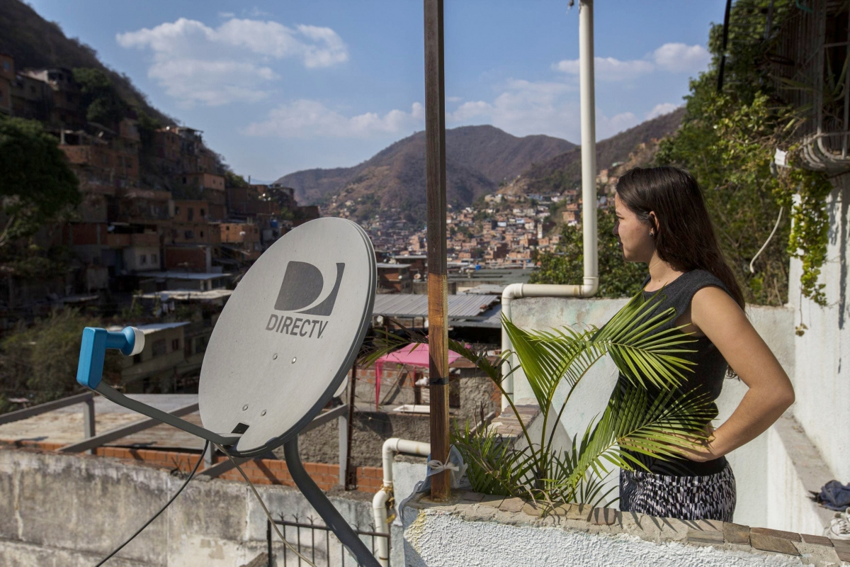 A DirecTV antena in a barrio house, Caracas. (Archive)