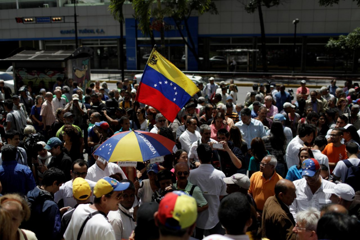 A small group of opposition supporters demonstrated outside the offices of the UN in Caracas on Monday. (Marco Bello/Reuters)