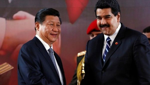 China's President Xi Jinping and Venezuela's President Nicolas Maduro shake hands during a signing ceremony in Caracas July 21, 2014. (Reuters)
