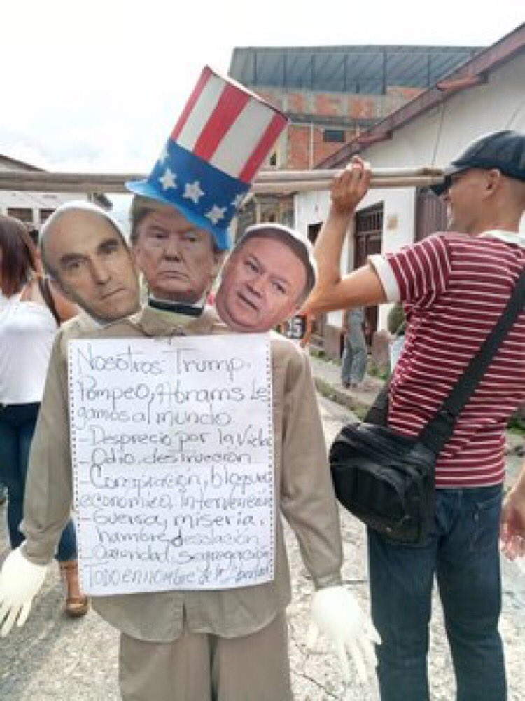 "Families took advantage of the traditional ""Judas doll burning"" to showcase their political loyalties. In this case, they depict the traitorous Judas with the faces of US President Donald Trump, US Special Envoy to Venezuela Elliott Abrams, and US Secretary of State Mike Pompeo. (@VillegasPoljak / Twitter)"