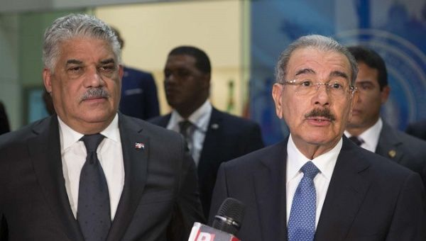 Dominican Foreign Minister Miguel Vargas and President Danilo Medina