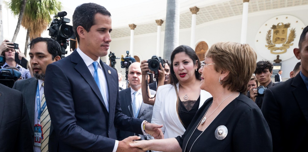 "National Assembly President and self-declared ""Interim President"" of Venezuela Juan Guaido receives Bachelet in Venezuela's National Legislative Assembly building. (EFE)"