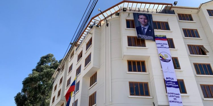 "A large Juan Guaido banner was hung outside Venezuela's embassy in La Paz, Bolivia on Friday in which he claims to be the country's ""legitimate"" president. (@Presidencia_VE)"