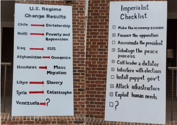 Two placards placed outside the Venezuelan embassy by the Embassy Protectors Collective. (Popular Resistance)