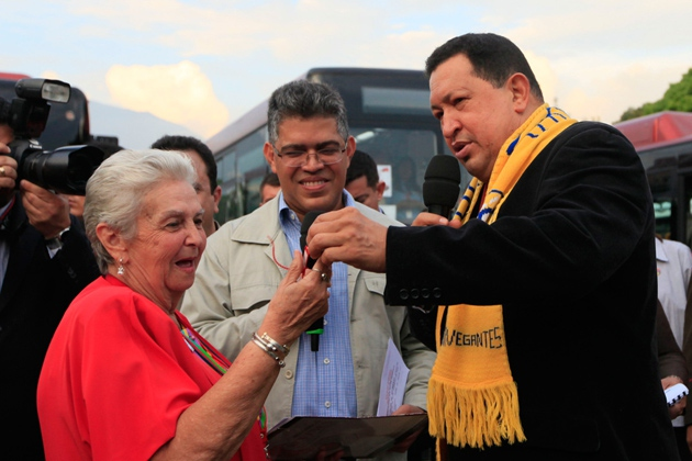 President Hugo Chavez hands over car keys to one of 200 recipients. (Archive)