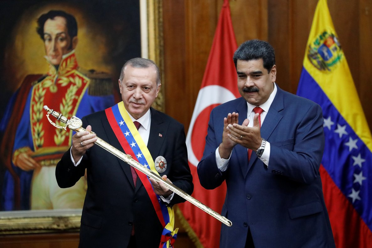 President Tayyip Erdogan holds a replica of the sword of national hero Simon Bolivar next to Venezuela's President Nicolas Maduro during an agreement-signing ceremony between Turkey and Venezuela at Miraflores Palace in Caracas, Venezuela. (Manaure Quintero / Reuters)