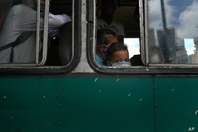 A Venezuelan child looks out the window of a bus. (AP)