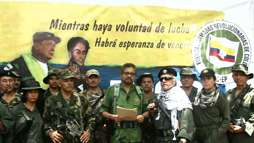 Colombian senators and ex-peace negotiators Ivan Marquez and Jesus Santrich announced the return to arms of a FARC-EP fraction in the Colombian jungle. (Jacobo Alape / Youtube)