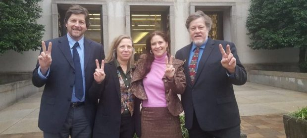 Embassy protectors [left to right: David Paul, Margaret Flowers, Adrienne Pine, Kevin Zeese] outside of court on February 13, 2020. (Martha Allen)
