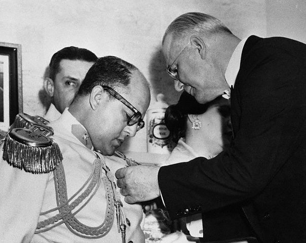 "Venezuelan dictator Marcos Perez Jimenez receiving the ""Legion of Merit"" from ambassador Fletcher Warren in 1954 (Wikimedia Commons)"