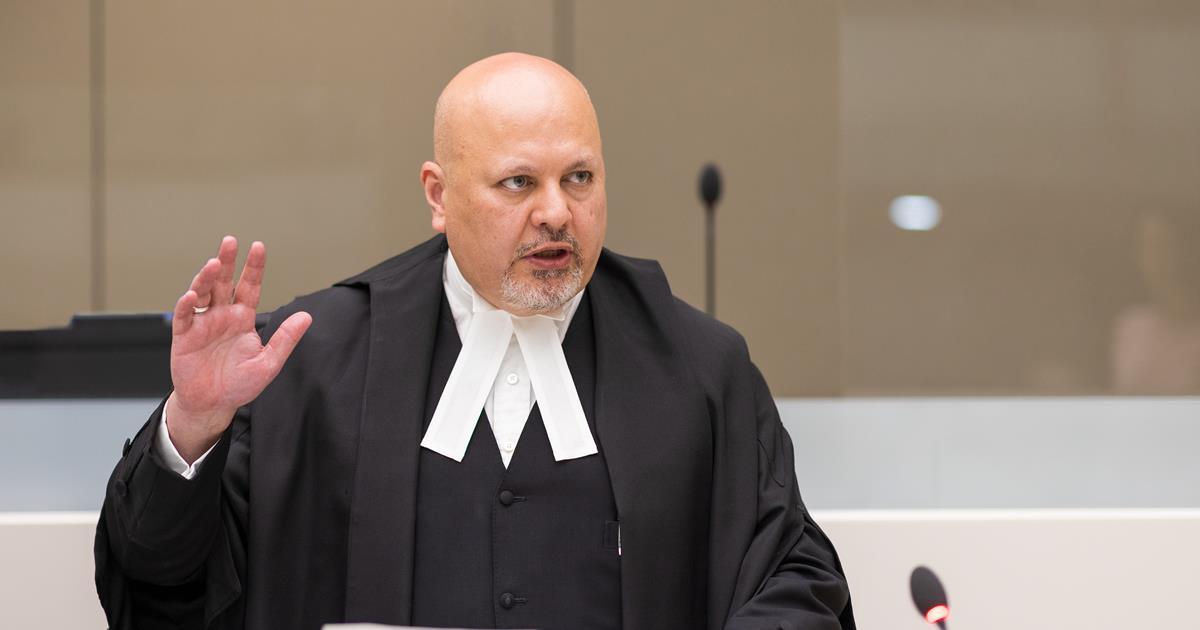 ICC Prosecutor Karim Khan raises his right hand in court