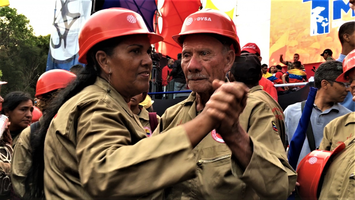 Workers from a range of industries turned out to back Maduro. Here oil workers danced their way around the march. (Javier Gomez)