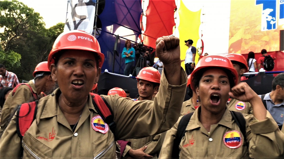 Female workers made up a significant percentage of the pro-government march, here representing the state run oil firm PDVSA. (Javier Gomez)