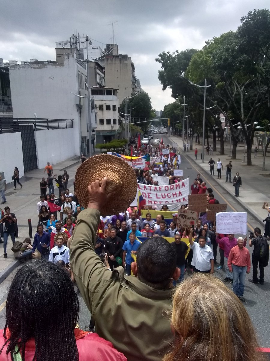 Campesino leader Jesus Osorio addresses the crowd in front of the Attorney General's office. (Jessica Dos Santos)